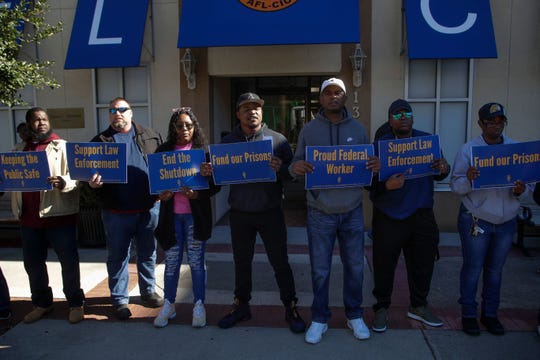 Federal workers gather in front of the Federation of Labor and Congress of Industrial Organizations (AFL-CIO) building in Tallahassee before marching to the Florida Historic Capitol in protest of the government shutdown Thursday, Jan. 10, 2019.