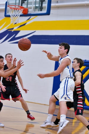 Oconto's Andrew Ramage passes to a teammate over the Sevastopol defense in their game Friday night.