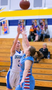 Aubree Bucheger of Oconto shoots over the defense of Hailey Shimon in the second half action against Southern Door on Jan. 24.