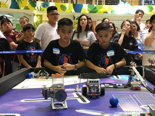 iLearn Lions watch their robot closely as it goes off on a mission during the FIRST Lego League Pacific Championships held at the Agana Shopping Center on Saturday, Jan. 26, 2019. There were a total of 22 teams from schools around the island competing for the top prize.