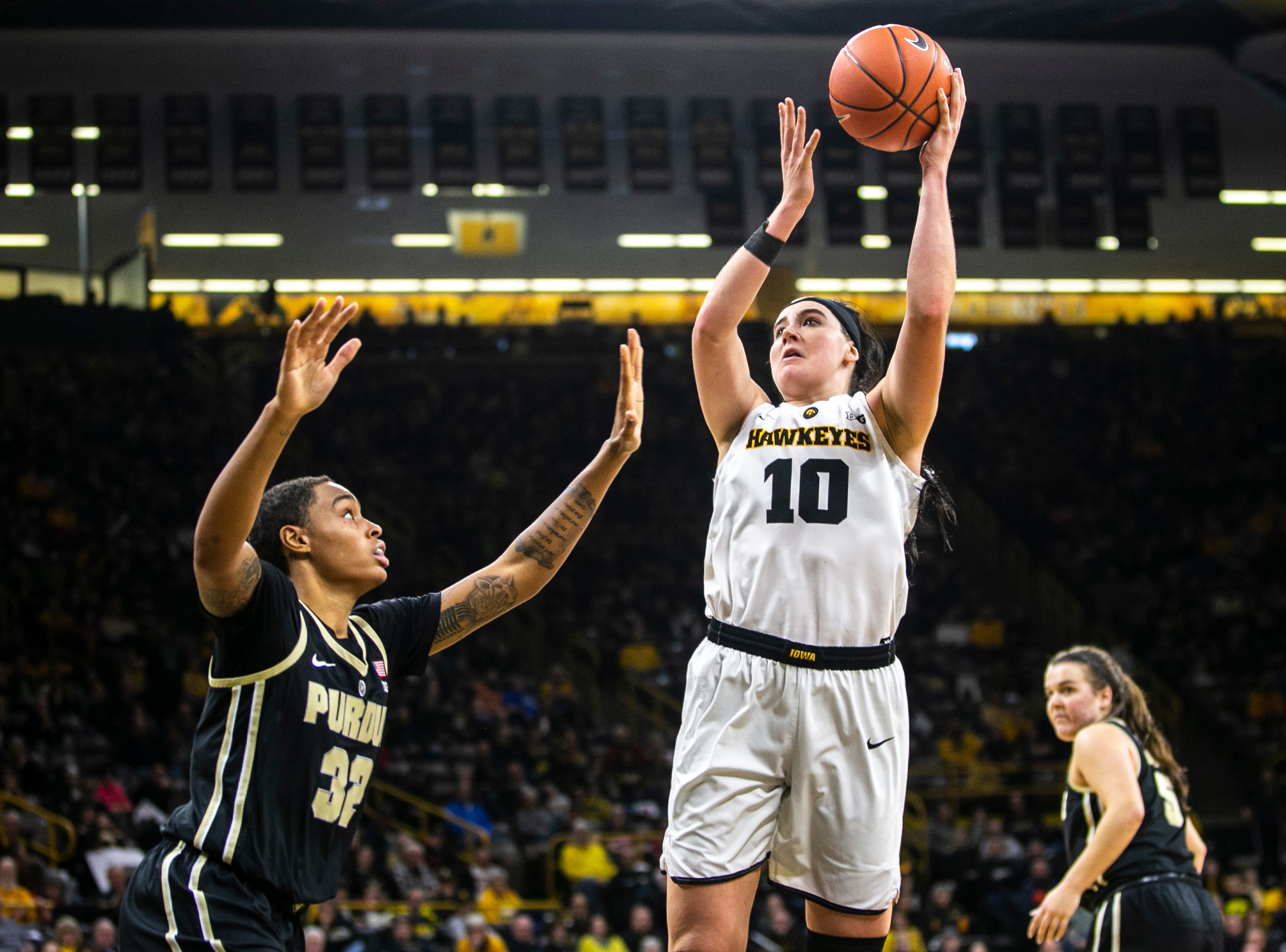 Iowa center Megan Gustafson (10) makes a shot past Purdue forward Ae'Rianna Harris (32) during a NCAA Big Ten Conference women's basketball game on Sunday, Jan. 27, 2019, at Carver-Hawkeye Arena in Iowa City, Iowa.