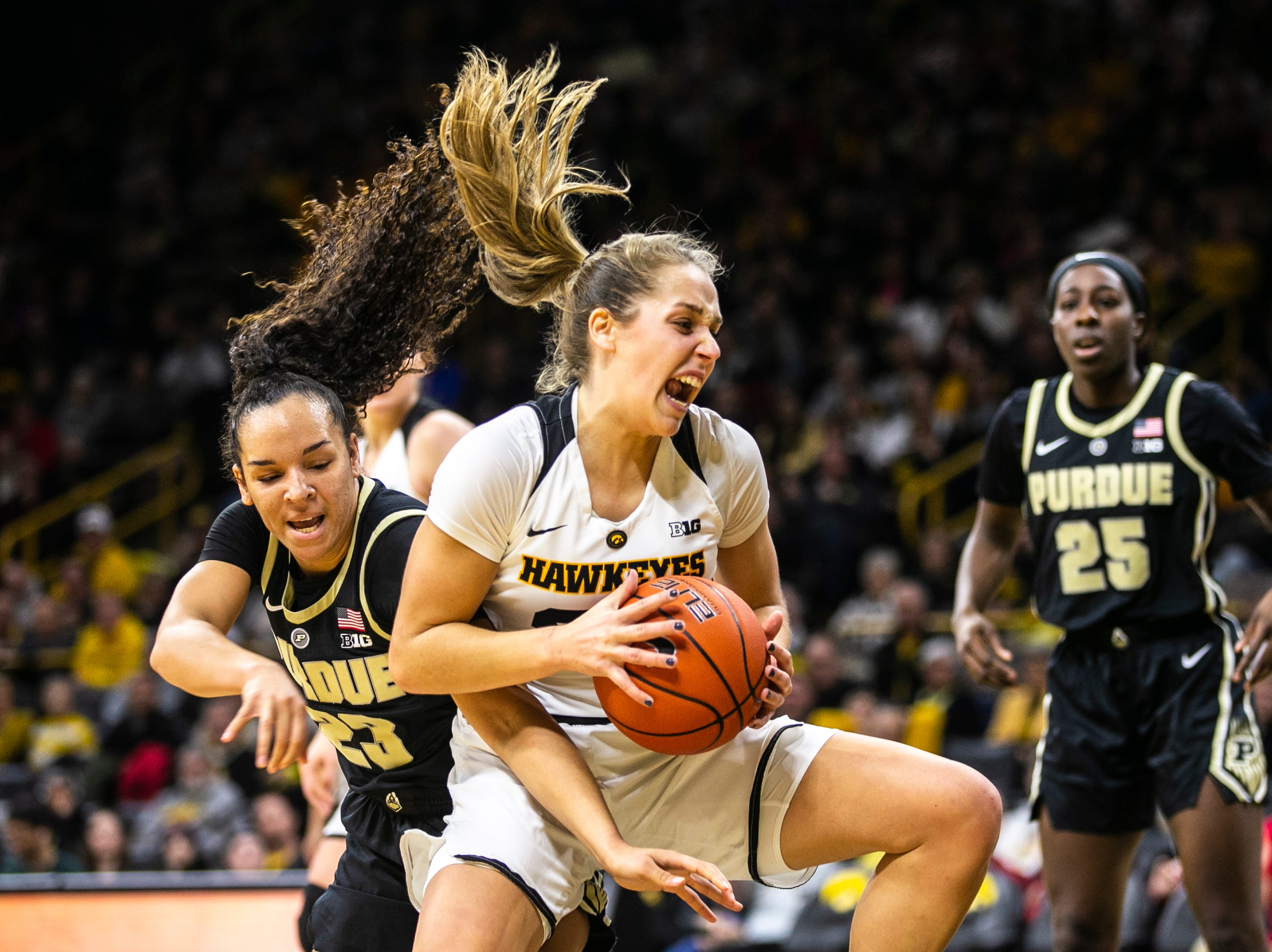 Iowa guard Kathleen Doyle drives to the hoop past Purdue guard Kayana Traylor (23) during a NCAA Big Ten Conference women's basketball game on Sunday, Jan. 27, 2019, at Carver-Hawkeye Arena in Iowa City, Iowa.