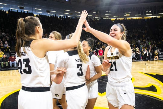 Iowa forward Hannah Stewart (21) high-fives Iowa forward Amanda Ollinger (43) after a NCAA Big Ten Conference women's basketball game on Sunday, Jan. 27, 2019, at Carver-Hawkeye Arena in Iowa City, Iowa. The Hawkeyes defeated Purdue, 72-58.