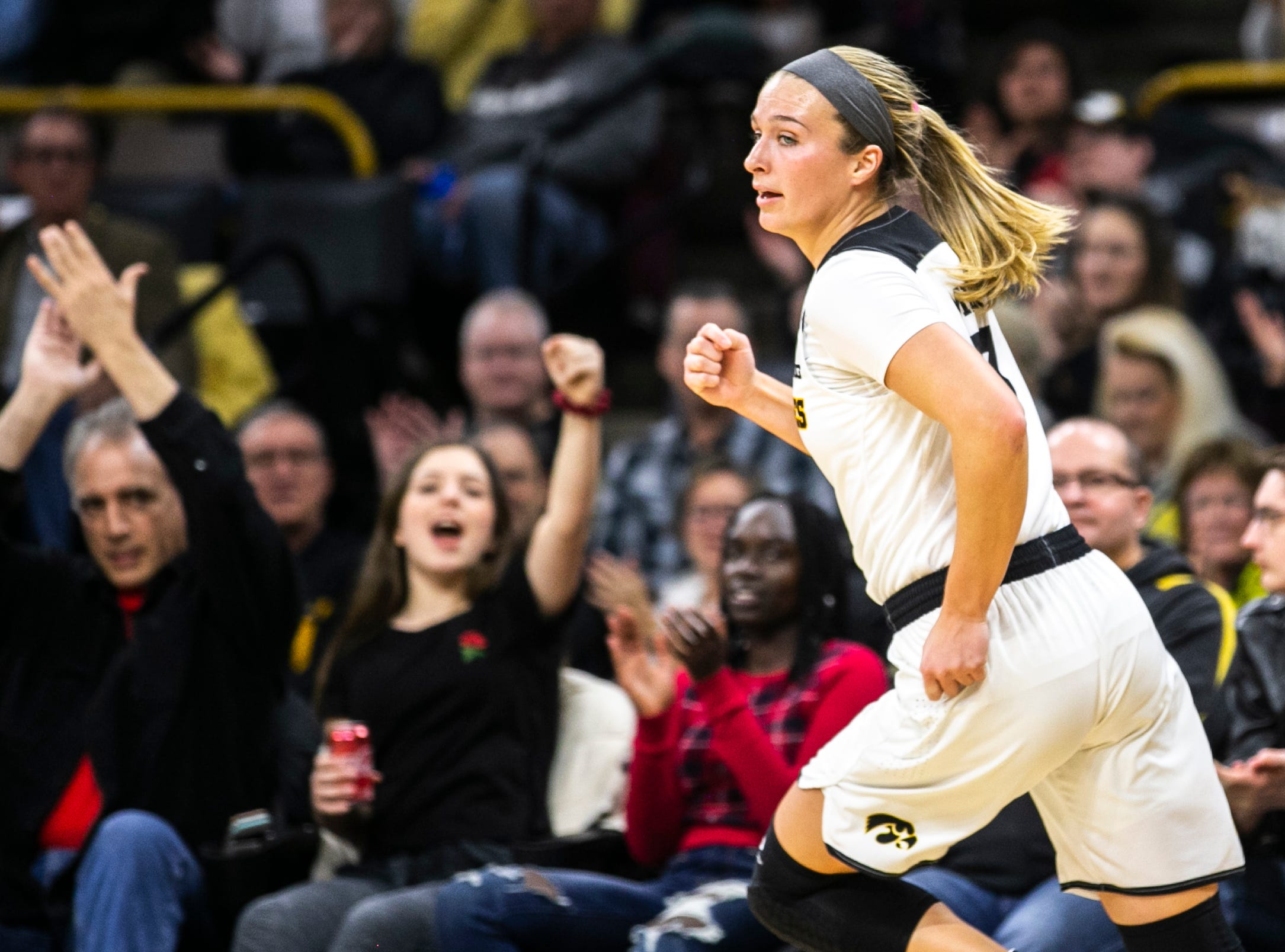 Iowa guard Makenzie Meyer (3) celebrates after making a layup during a NCAA Big Ten Conference women's basketball game on Sunday, Jan. 27, 2019, at Carver-Hawkeye Arena in Iowa City, Iowa.