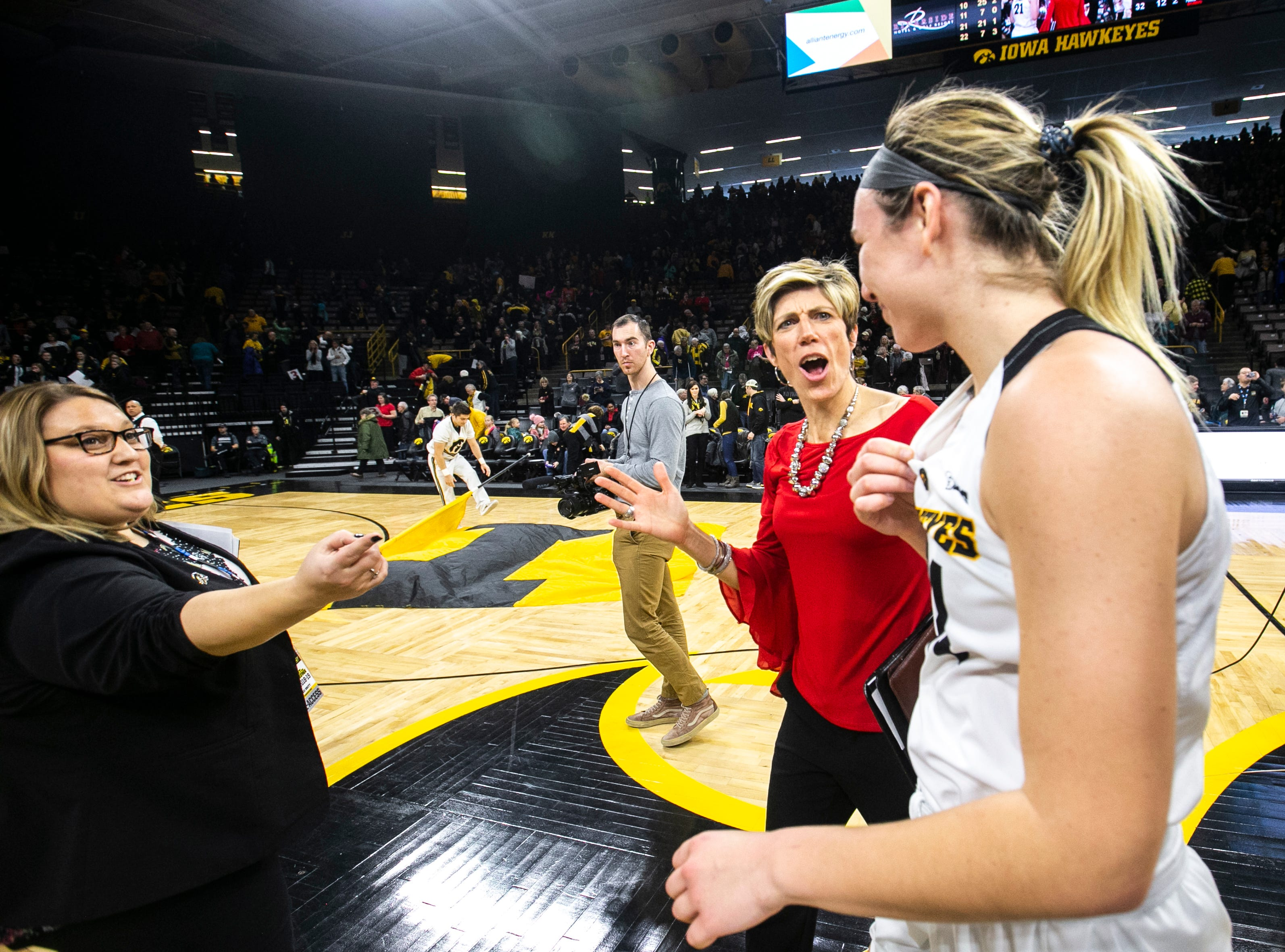 Iowa forward Hannah Stewart right talks with associate coach Jan Jensen after a NCAA Big Ten Conference women's basketball game on Sunday, Jan. 27, 2019, at Carver-Hawkeye Arena in Iowa City, Iowa.