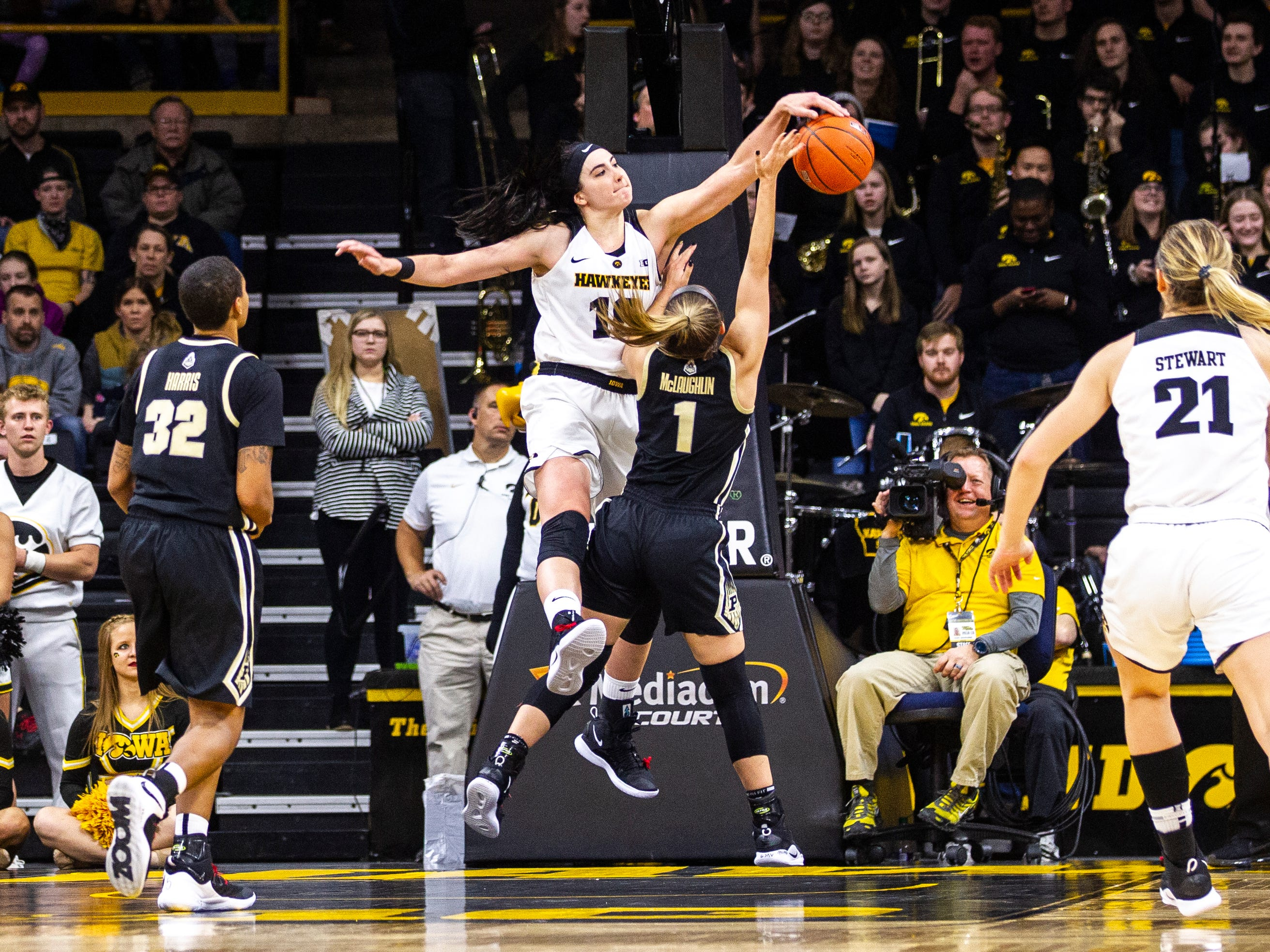 Iowa center Megan Gustafson (10) blocks Purdue guard Karissa McLaughlin (1) during a NCAA Big Ten Conference women's basketball game on Sunday, Jan. 27, 2019, at Carver-Hawkeye Arena in Iowa City, Iowa.