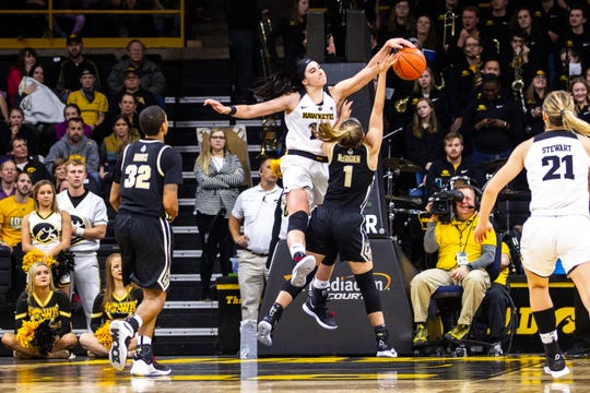 Megan Gustafson's resounding block of Purdue guard Karissa McLaughlin essentially closed out Iowa's 72-58 win Sunday afternoon at Carver-Hawkeye Arena.