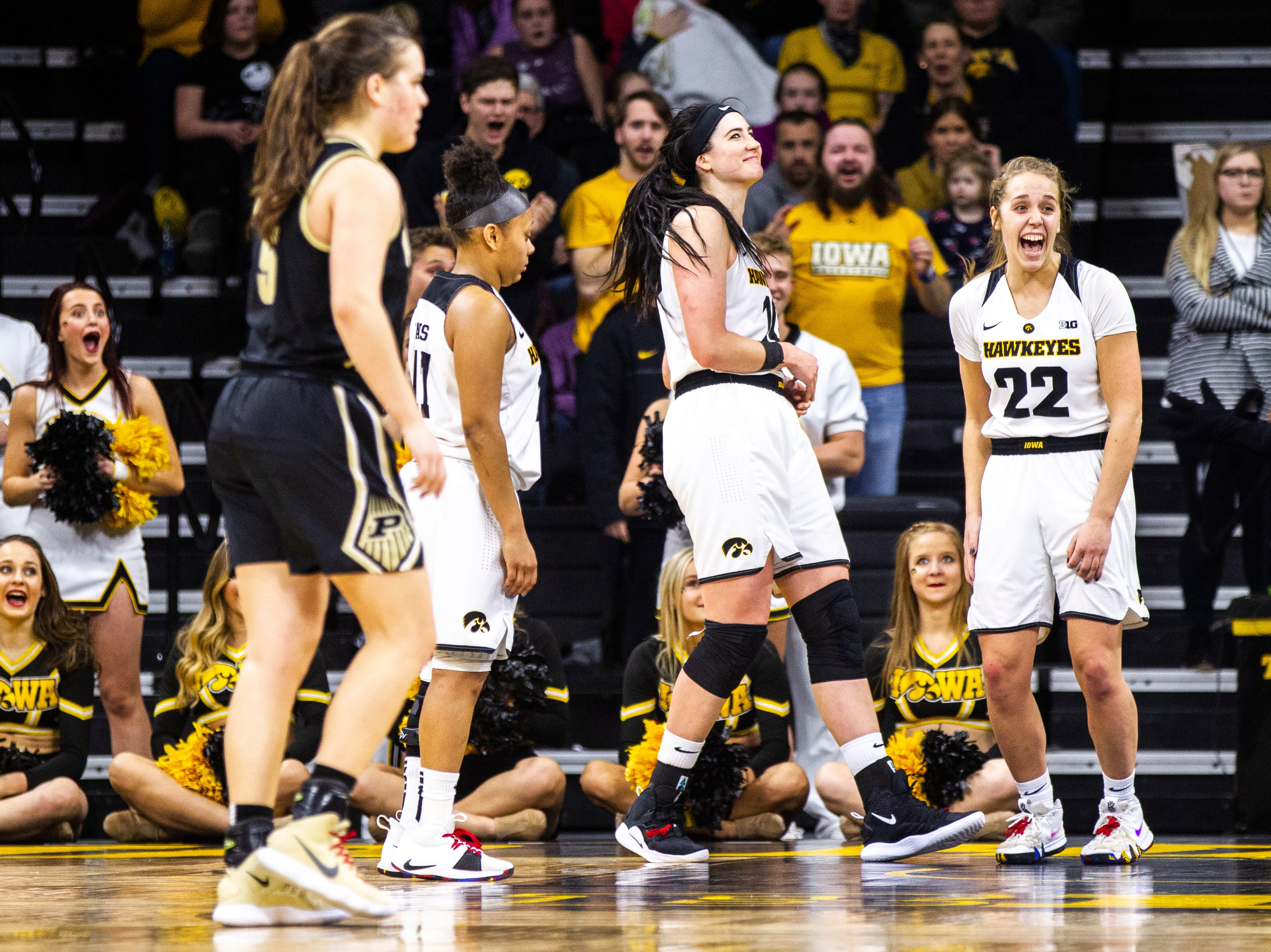 Iowa guard Kathleen Doyle (22) laughs after Iowa center Megan Gustafson (10) blocked a shot during a NCAA Big Ten Conference women's basketball game on Sunday, Jan. 27, 2019, at Carver-Hawkeye Arena in Iowa City, Iowa.