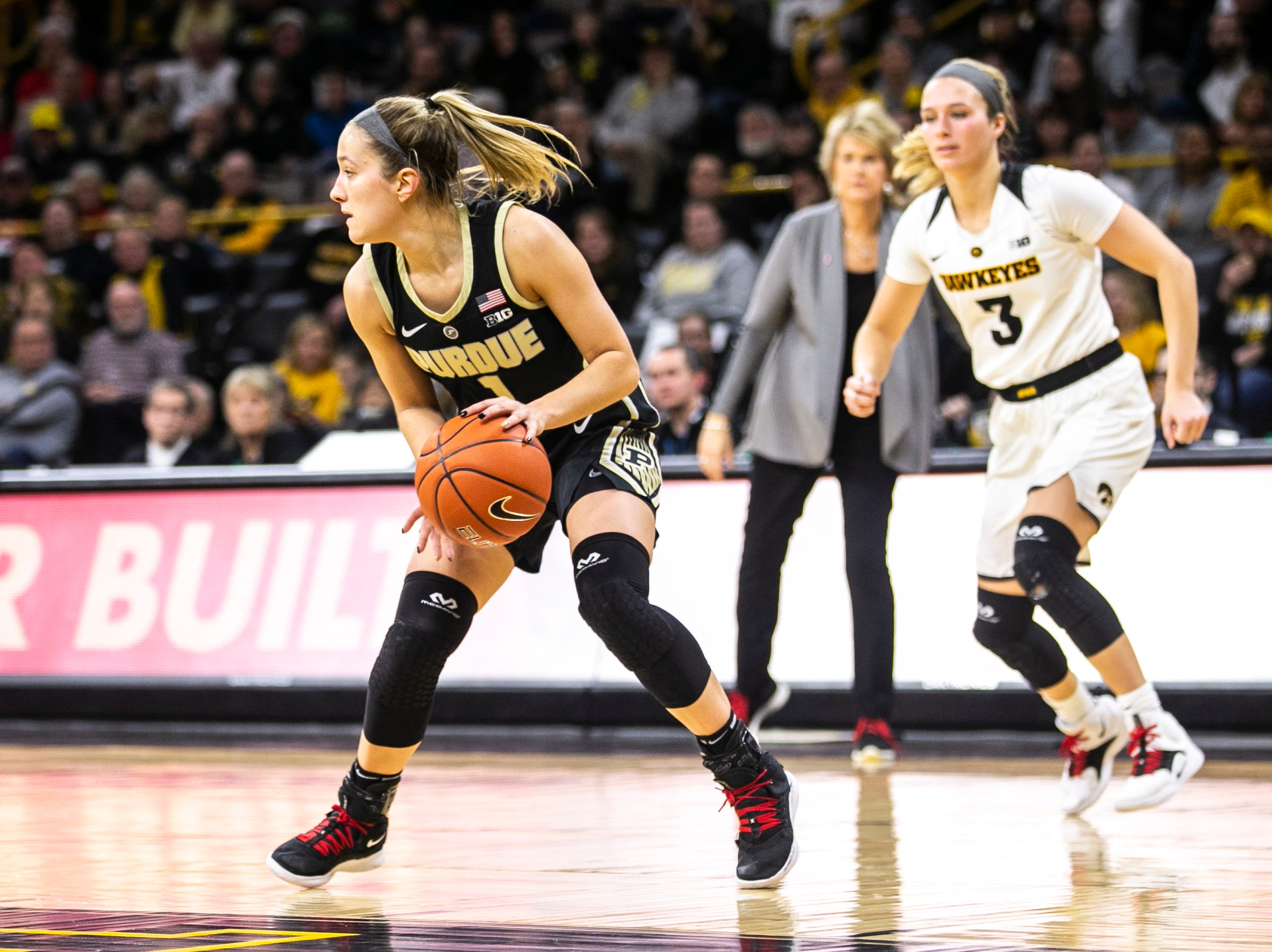 Purdue guard Karissa McLaughlin grabs a rebound during a NCAA Big Ten Conference women's basketball game on Sunday, Jan. 27, 2019, at Carver-Hawkeye Arena in Iowa City, Iowa.