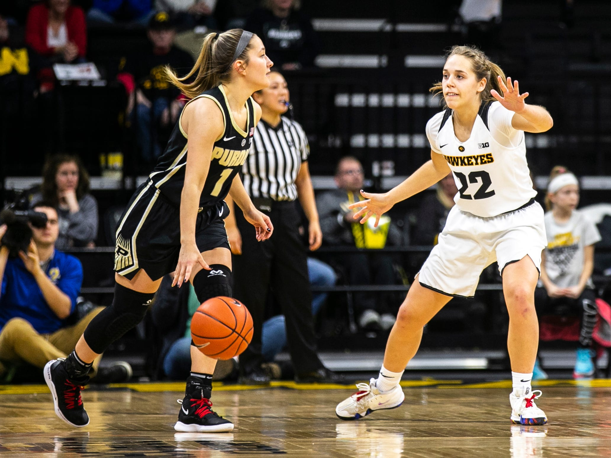 Iowa guard Kathleen Doyle (22) defends Purdue guard Karissa McLaughlin (1) during a NCAA Big Ten Conference women's basketball game on Sunday, Jan. 27, 2019, at Carver-Hawkeye Arena in Iowa City, Iowa.
