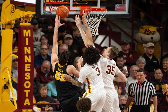 Iowa center Luka Garza heads to the basket for two of his 25 points against Minnesota on Sunday. That tied a career-high for the sophomore and marked his fourth consecutive game with at least 20 points. But Garza was disappointed in his defense. Iowa lost 92-87.