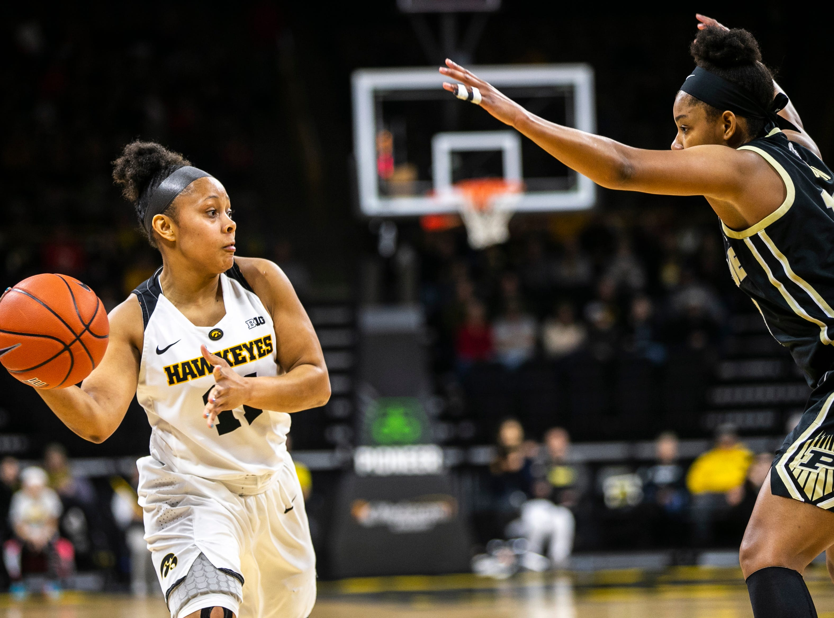 Iowa guard Tania Davis, left, gets defended by Purdue guard Dominique Oden (11) during a NCAA Big Ten Conference women's basketball game on Sunday, Jan. 27, 2019, at Carver-Hawkeye Arena in Iowa City, Iowa.
