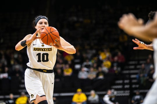Iowa center Megan Gustafson (10) passes to a teammate during a NCAA Big Ten Conference women's basketball game on Sunday, Jan. 27, 2019, at Carver-Hawkeye Arena in Iowa City, Iowa.