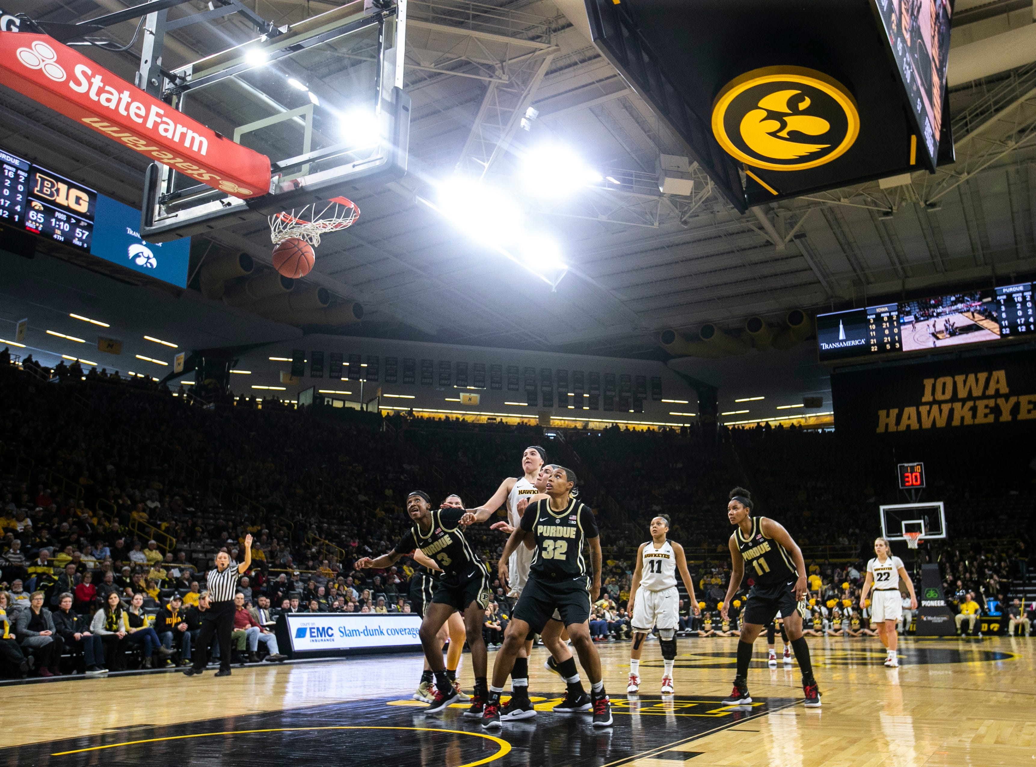 Iowa guard Tania Davis (11) looks on as her free-throw falls through the basket during a NCAA Big Ten Conference women's basketball game on Sunday, Jan. 27, 2019, at Carver-Hawkeye Arena in Iowa City, Iowa.