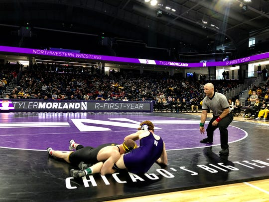 Iowa's Alex Marinelli takes down Northwestern's Tyler Morland during their match at Welsh-Ryan Arena on Sunday, Jan. 27, 2019. Marinelli beat Morland, 12-4, at 165 pounds.