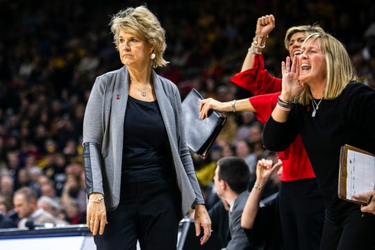 Iowa head coach Lisa Bluder walks the baseline while associates Jan Jensen and Jenni Fitzgerald call out to players during a NCAA Big Ten Conference women's basketball game on Sunday, Jan. 27, 2019, at Carver-Hawkeye Arena in Iowa City, Iowa.