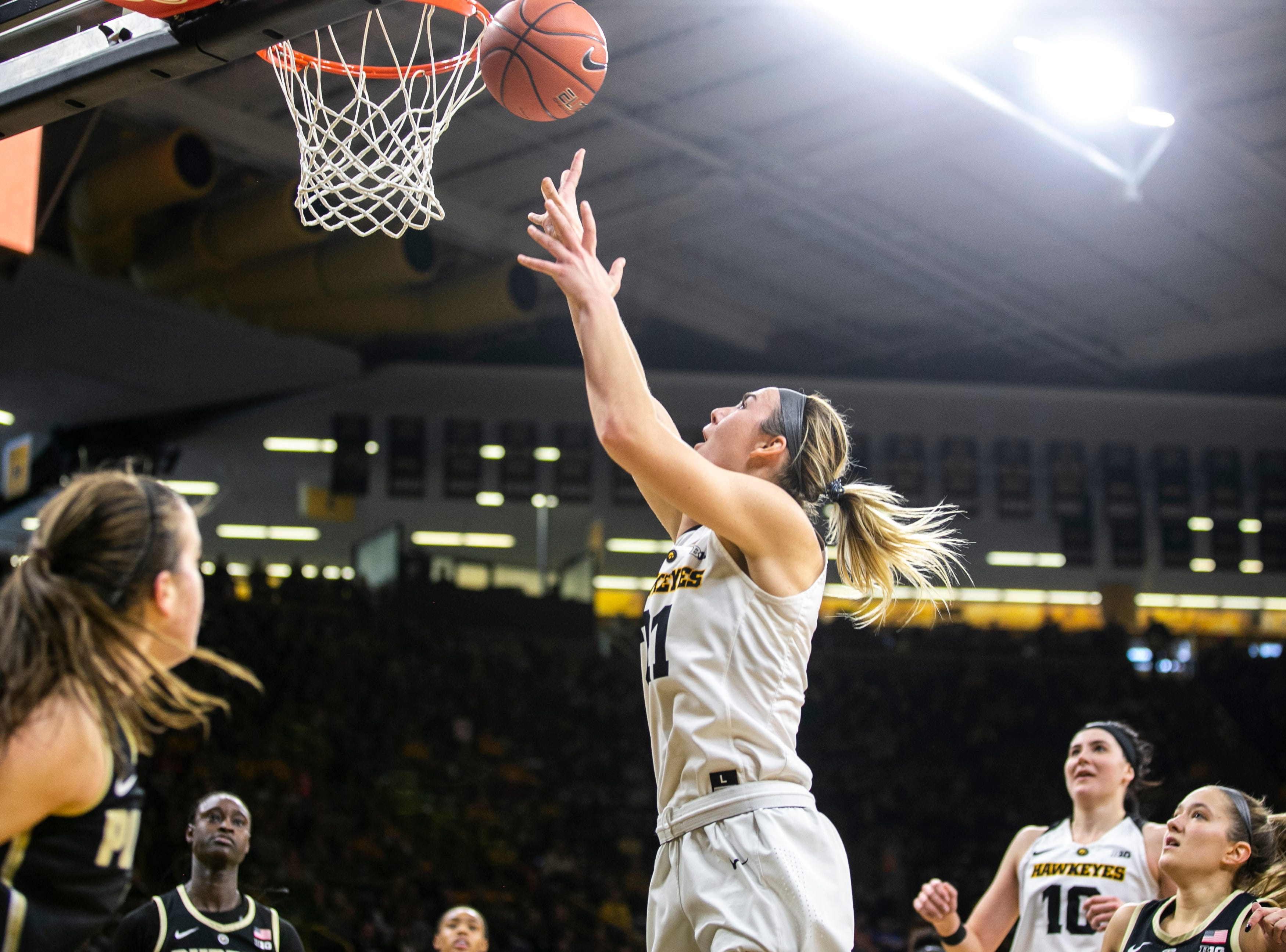 Iowa forward Hannah Stewart (21) makes a basket during a NCAA Big Ten Conference women's basketball game on Sunday, Jan. 27, 2019, at Carver-Hawkeye Arena in Iowa City, Iowa.
