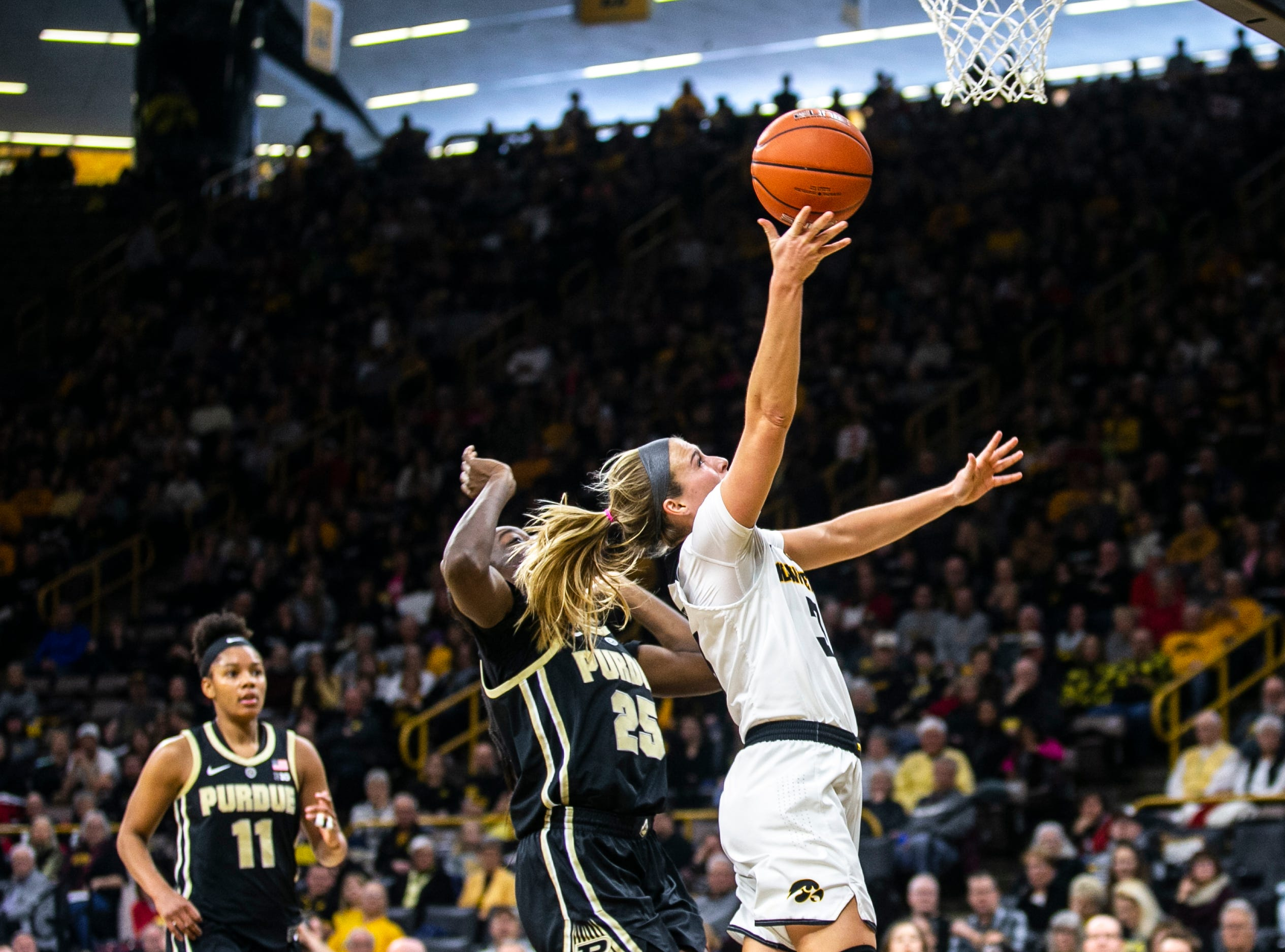 Iowa guard Makenzie Meyer (3) makes a layup during a NCAA Big Ten Conference women's basketball game on Sunday, Jan. 27, 2019, at Carver-Hawkeye Arena in Iowa City, Iowa.