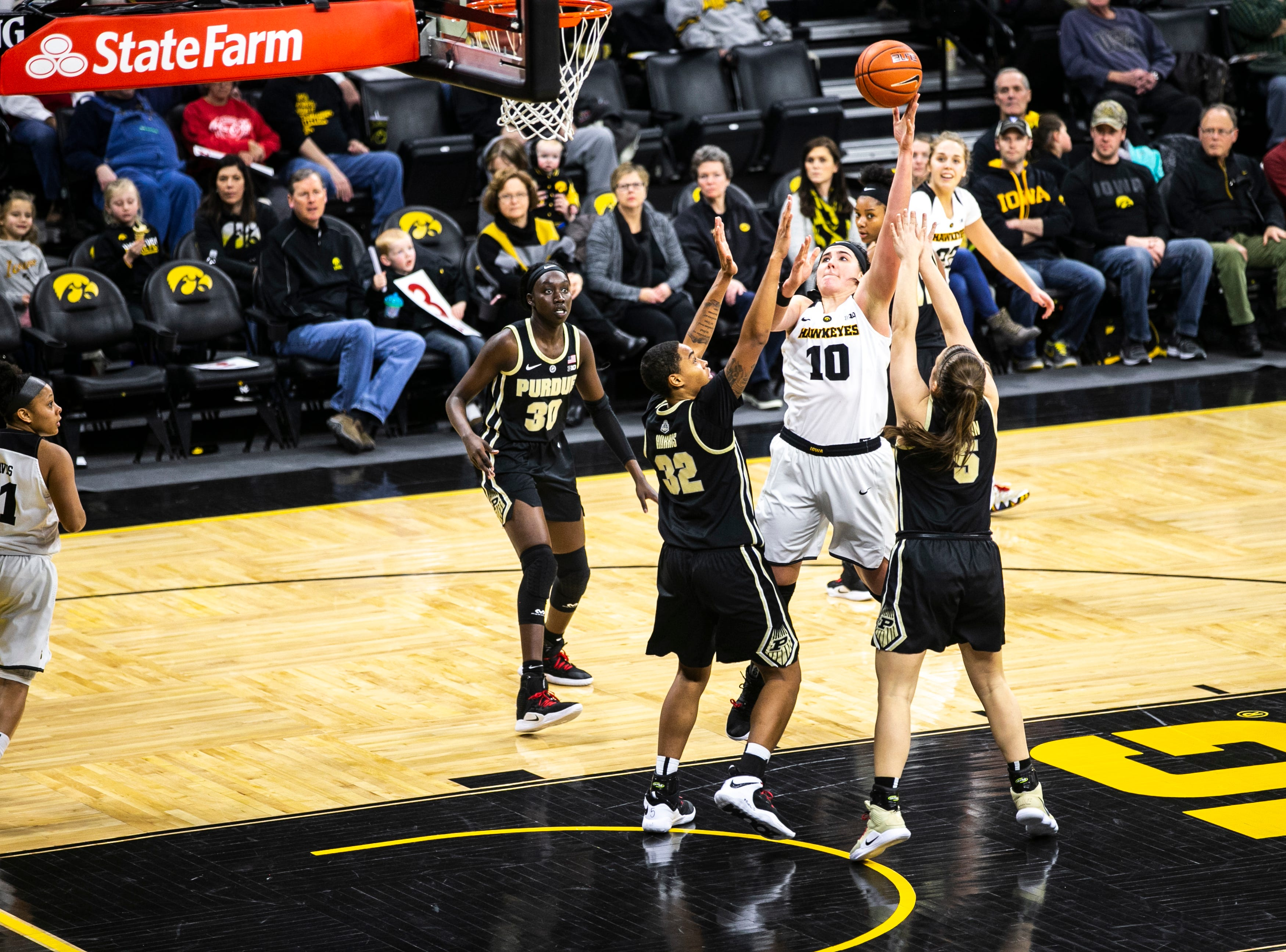 Iowa center Megan Gustafson (10) attempts a basket in the paint during a NCAA Big Ten Conference women's basketball game on Sunday, Jan. 27, 2019, at Carver-Hawkeye Arena in Iowa City, Iowa.