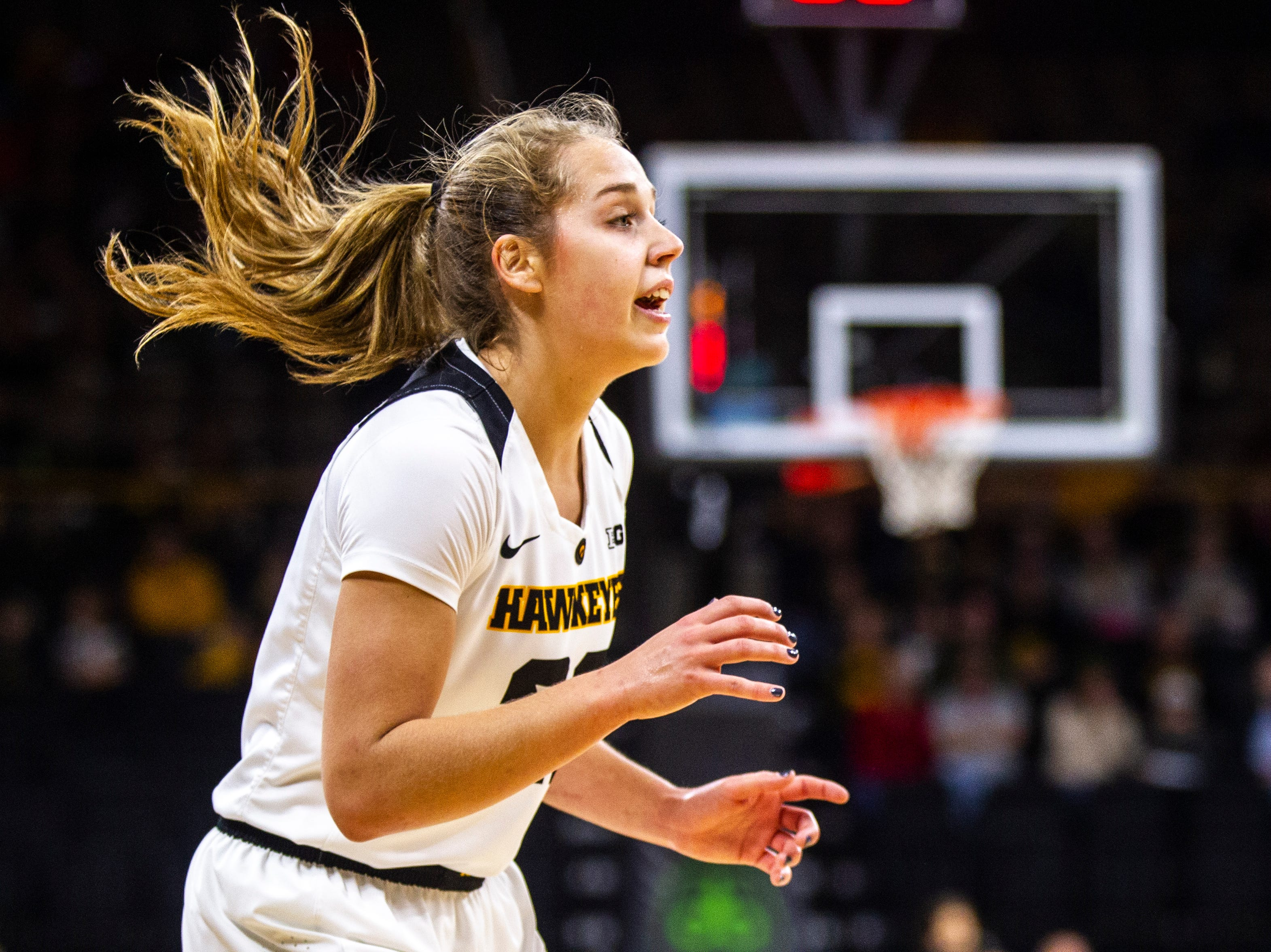 Iowa guard Kathleen Doyle (22) calls out to teammates during a NCAA Big Ten Conference women's basketball game on Sunday, Jan. 27, 2019, at Carver-Hawkeye Arena in Iowa City, Iowa.
