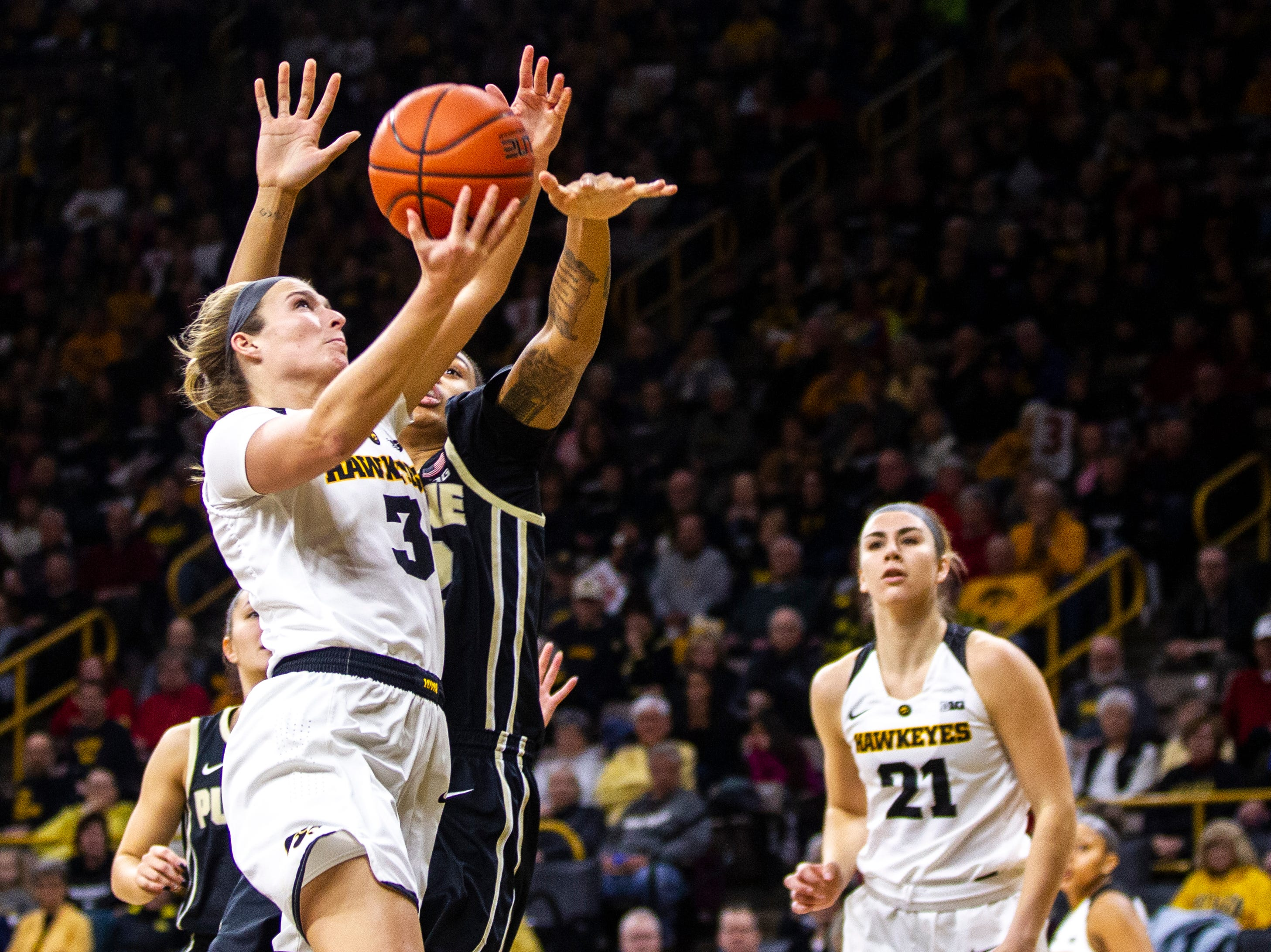 Iowa guard Makenzie Meyer (3) drives to the hoop for a layup during a NCAA Big Ten Conference women's basketball game on Sunday, Jan. 27, 2019, at Carver-Hawkeye Arena in Iowa City, Iowa.