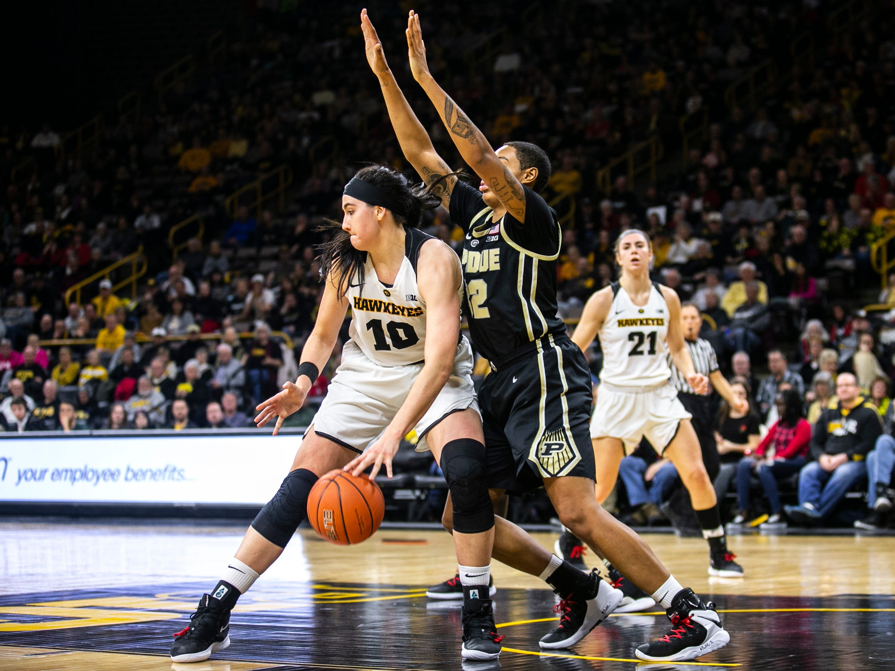 Iowa center Megan Gustafson (10) gets defended by Purdue forward Ae'Rianna Harris during a NCAA Big Ten Conference women's basketball game on Sunday, Jan. 27, 2019, at Carver-Hawkeye Arena in Iowa City, Iowa.