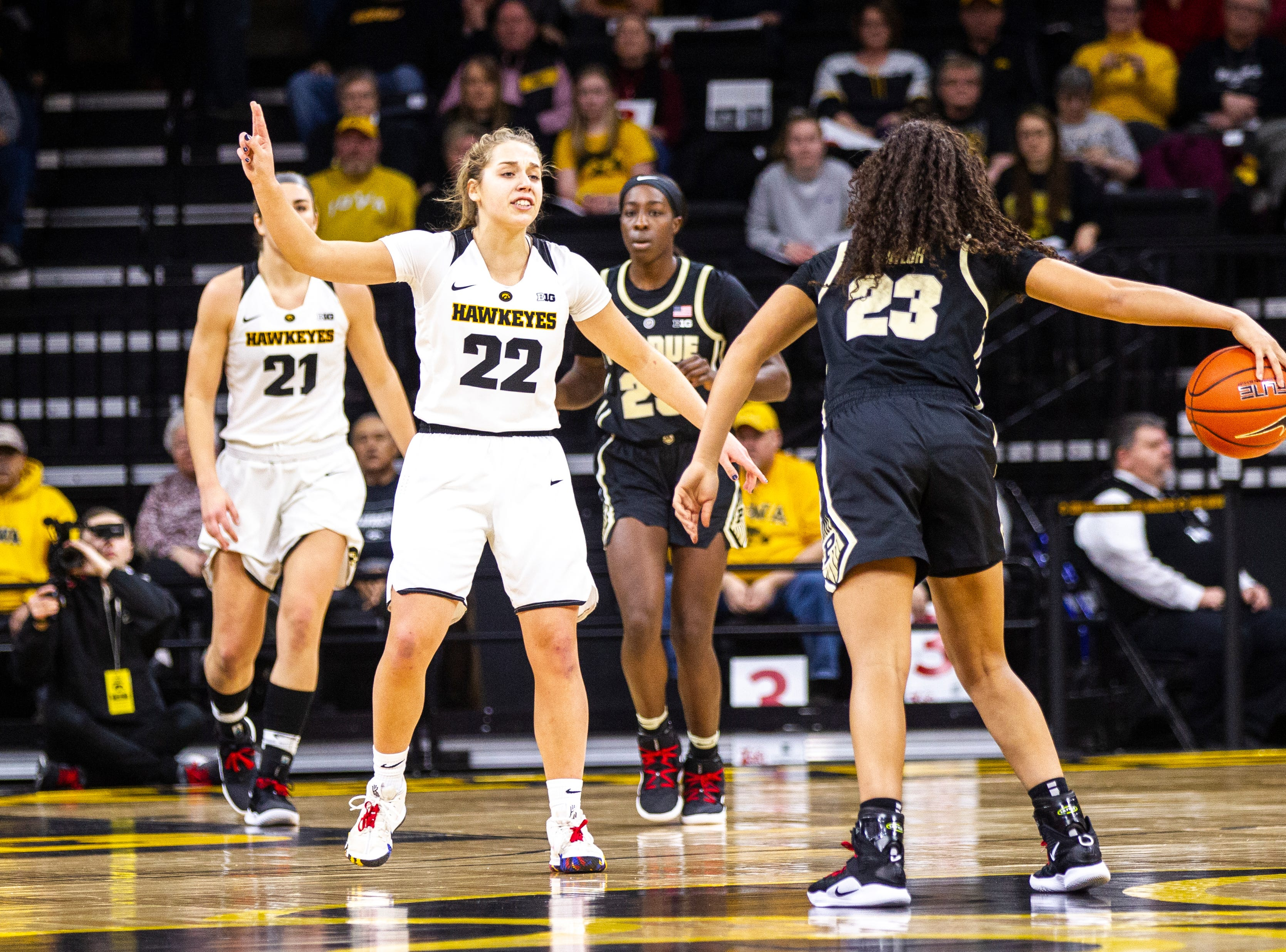 Iowa guard Kathleen Doyle (22) settles in on defense during a NCAA Big Ten Conference women's basketball game on Sunday, Jan. 27, 2019, at Carver-Hawkeye Arena in Iowa City, Iowa.