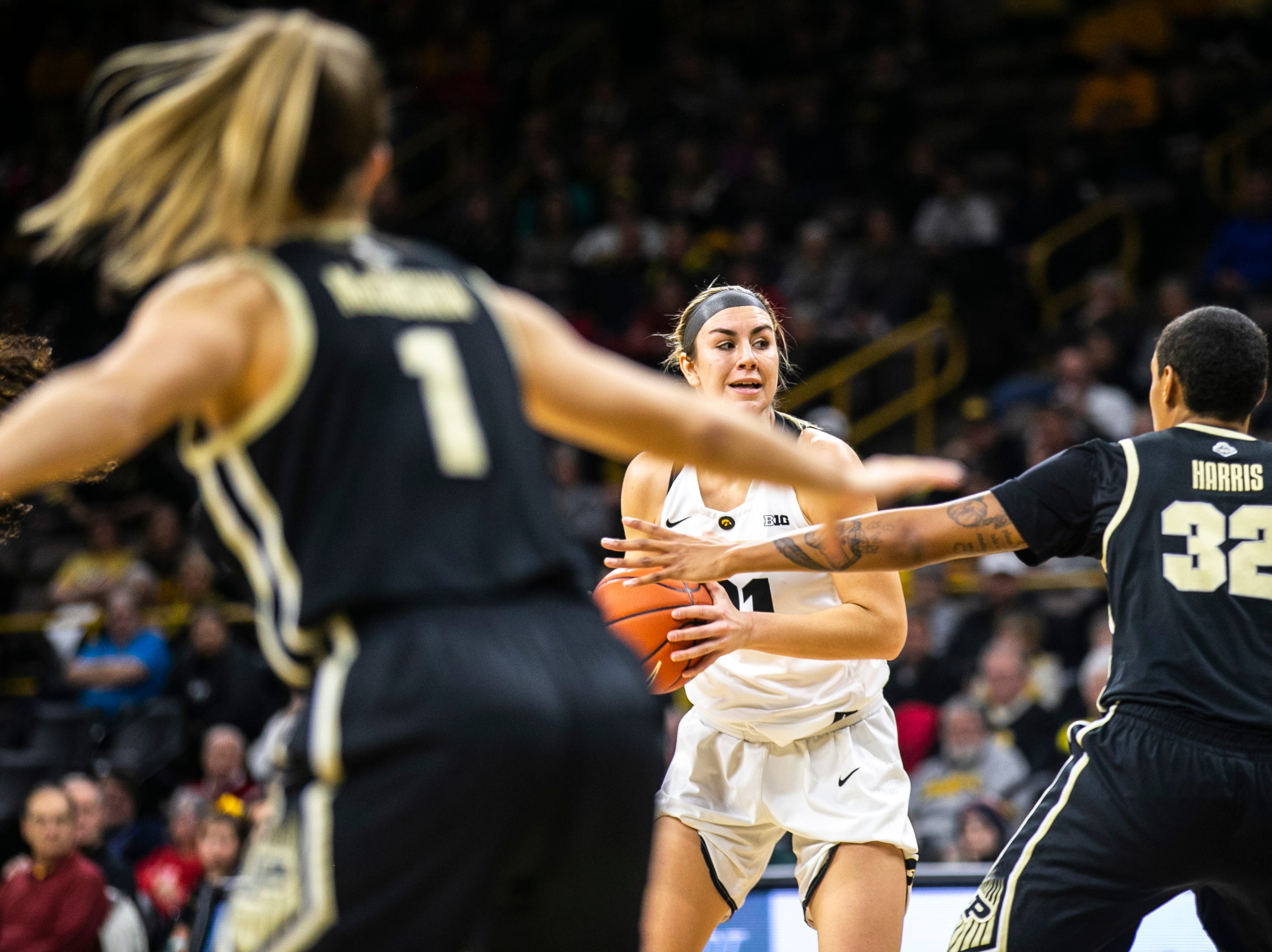 Iowa forward Hannah Stewart (21) looks to pass during a NCAA Big Ten Conference women's basketball game on Sunday, Jan. 27, 2019, at Carver-Hawkeye Arena in Iowa City, Iowa.