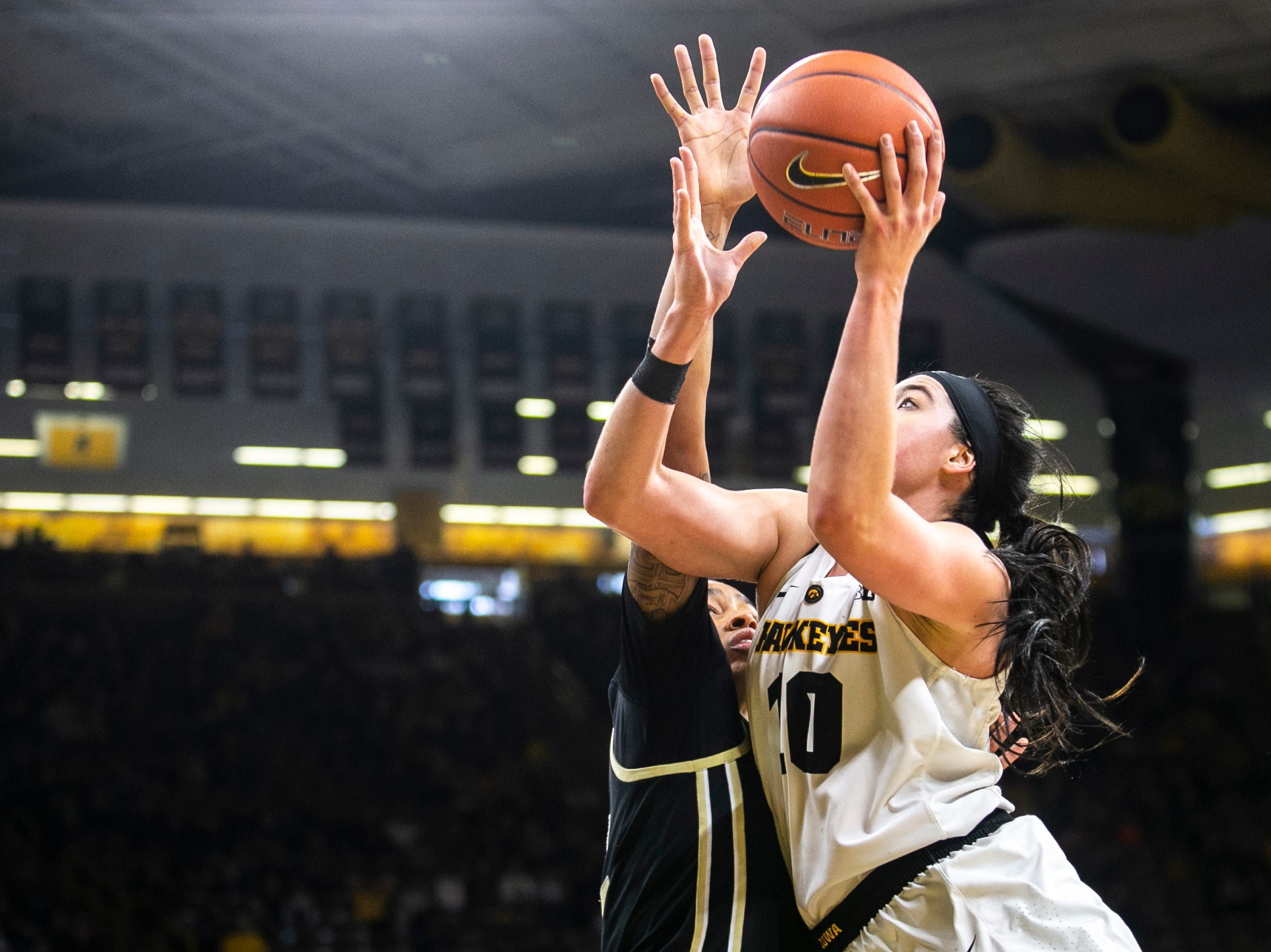 Iowa center Megan Gustafson (10) drives to the hoop past Purdue forward Ae'Rianna Harris during a NCAA Big Ten Conference women's basketball game on Sunday, Jan. 27, 2019, at Carver-Hawkeye Arena in Iowa City, Iowa.