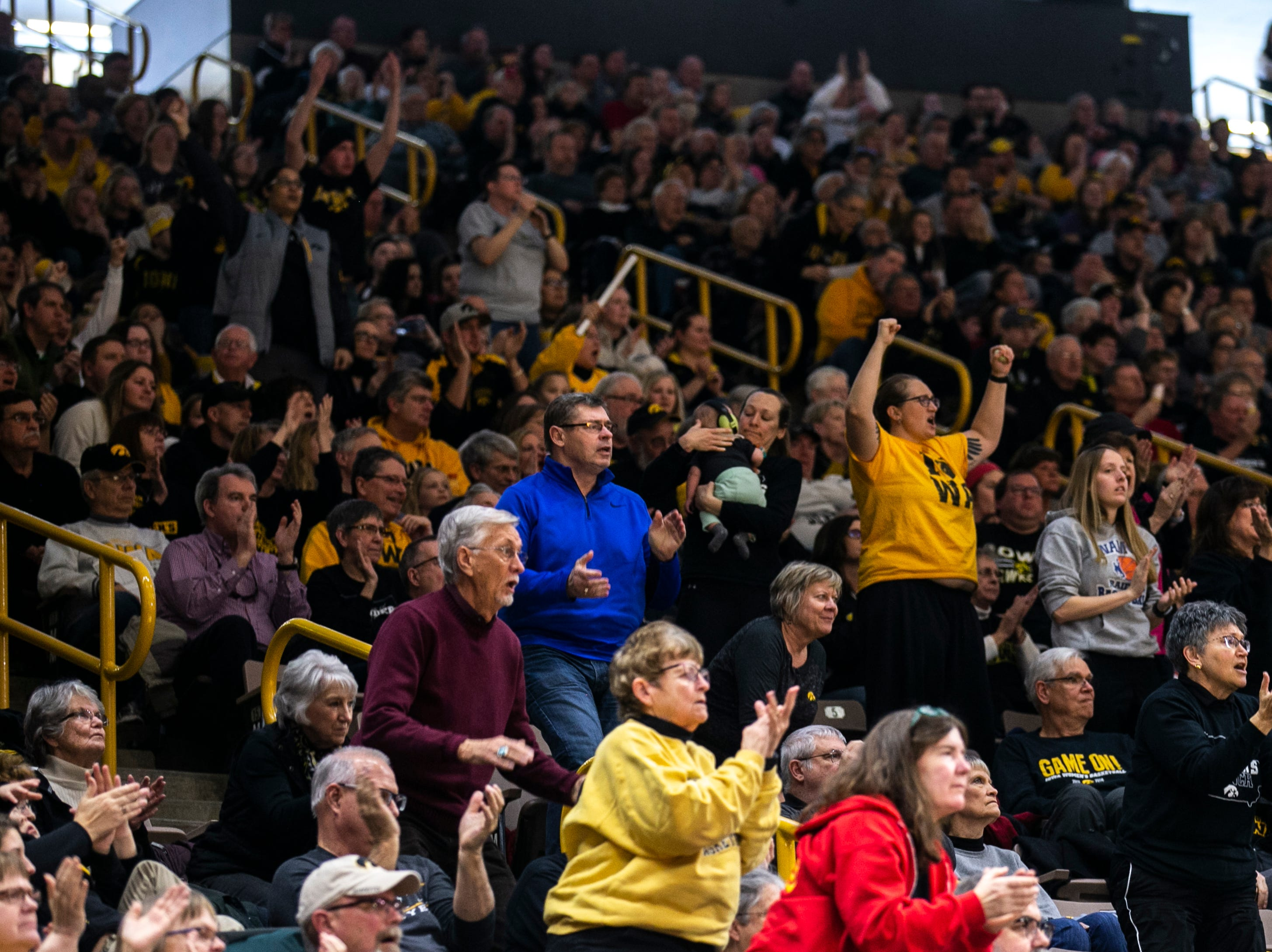 Iowa Hawkeyes fans cheer during a NCAA Big Ten Conference women's basketball game on Sunday, Jan. 27, 2019, at Carver-Hawkeye Arena in Iowa City, Iowa.