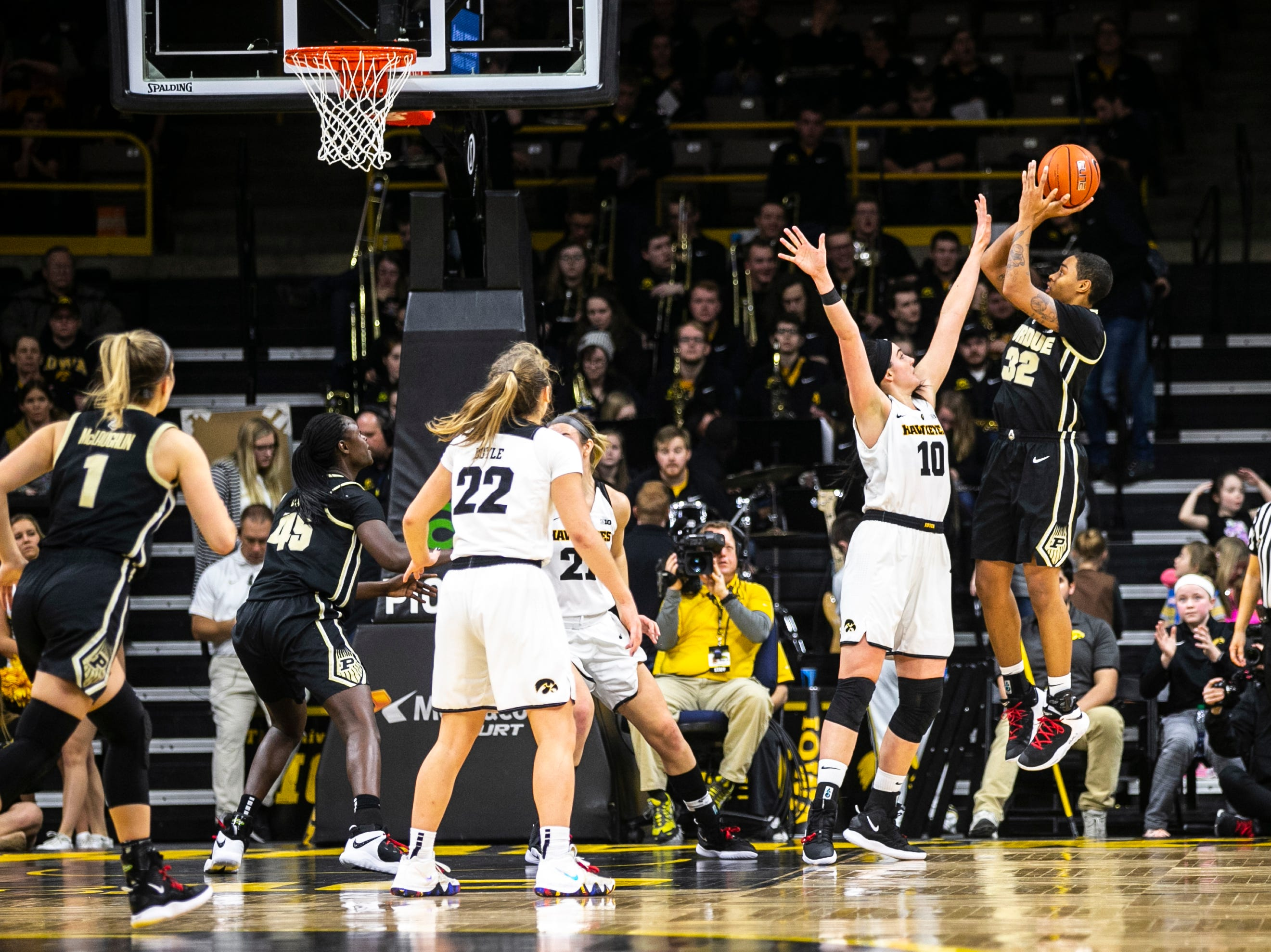 Iowa center Megan Gustafson (10) defends Purdue forward Ae'Rianna Harris (32) during a NCAA Big Ten Conference women's basketball game on Sunday, Jan. 27, 2019, at Carver-Hawkeye Arena in Iowa City, Iowa.