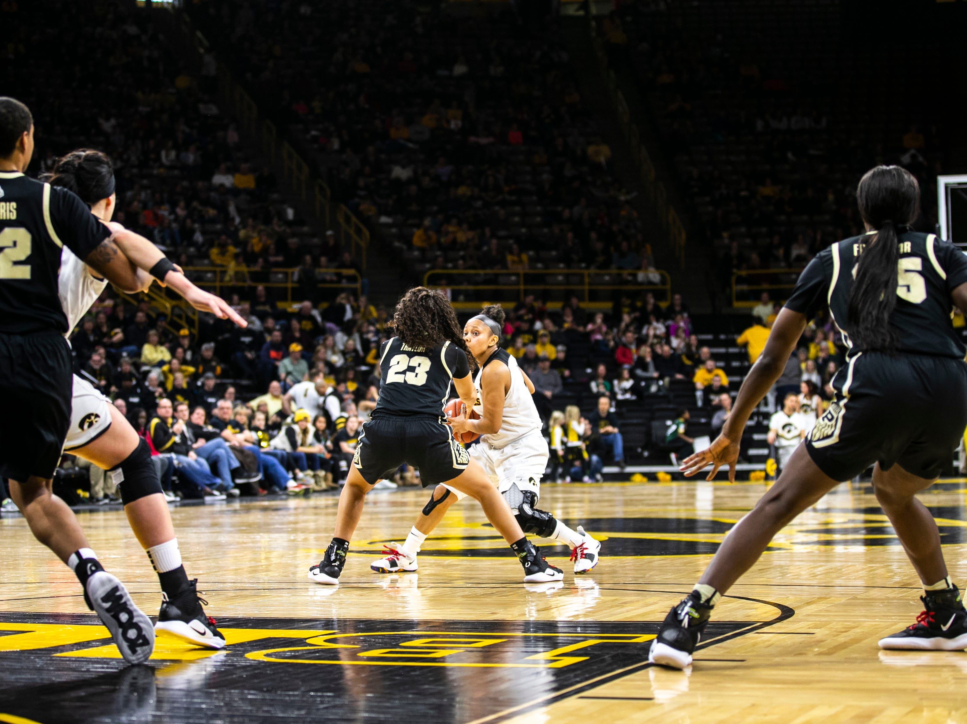 Iowa guard Tania Davis (11) looks to pass during a NCAA Big Ten Conference women's basketball game on Sunday, Jan. 27, 2019, at Carver-Hawkeye Arena in Iowa City, Iowa.