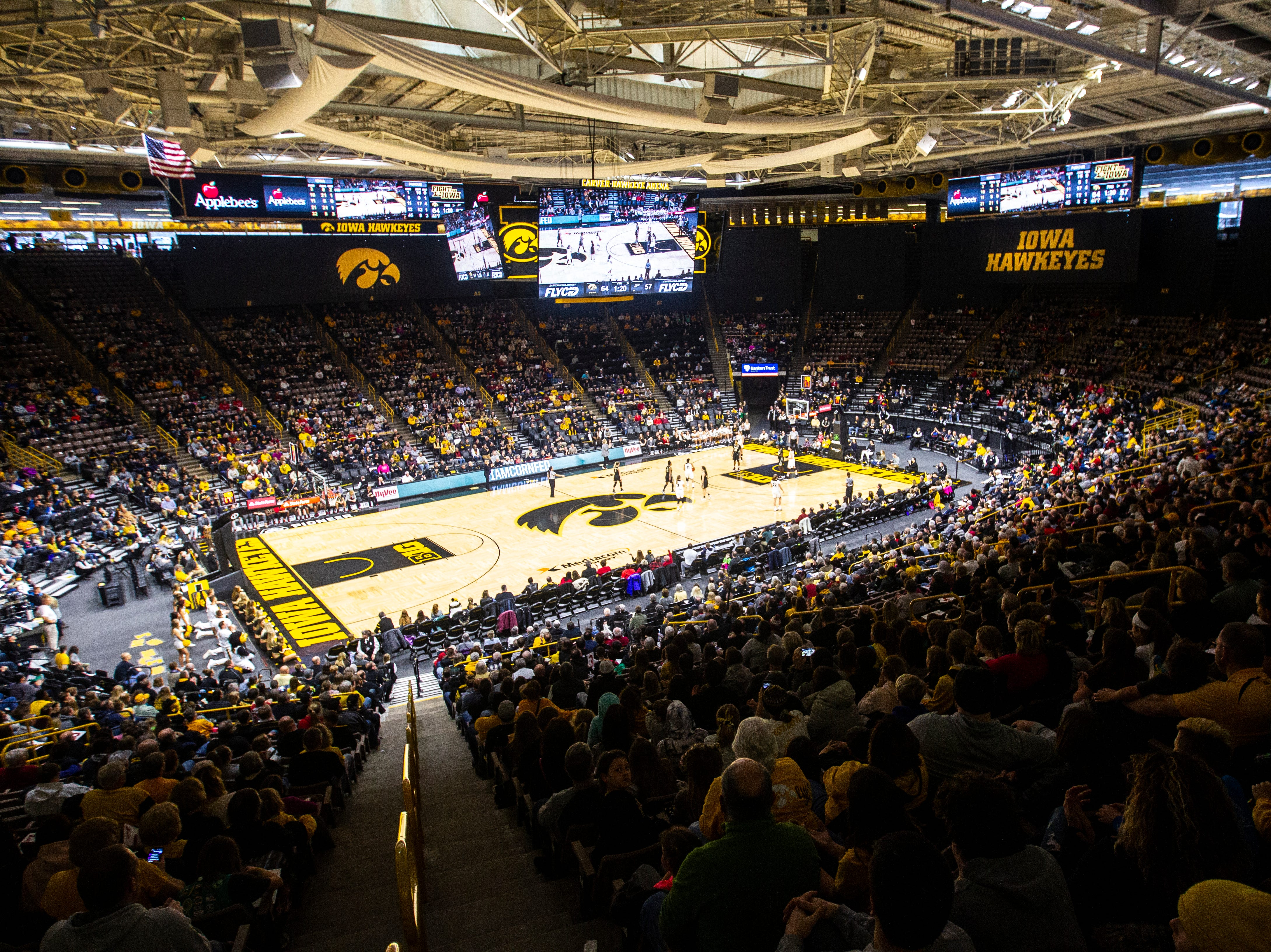 Iowa Hawkeyes fans watch the final minute of play during a NCAA Big Ten Conference women's basketball game on Sunday, Jan. 27, 2019, at Carver-Hawkeye Arena in Iowa City, Iowa.