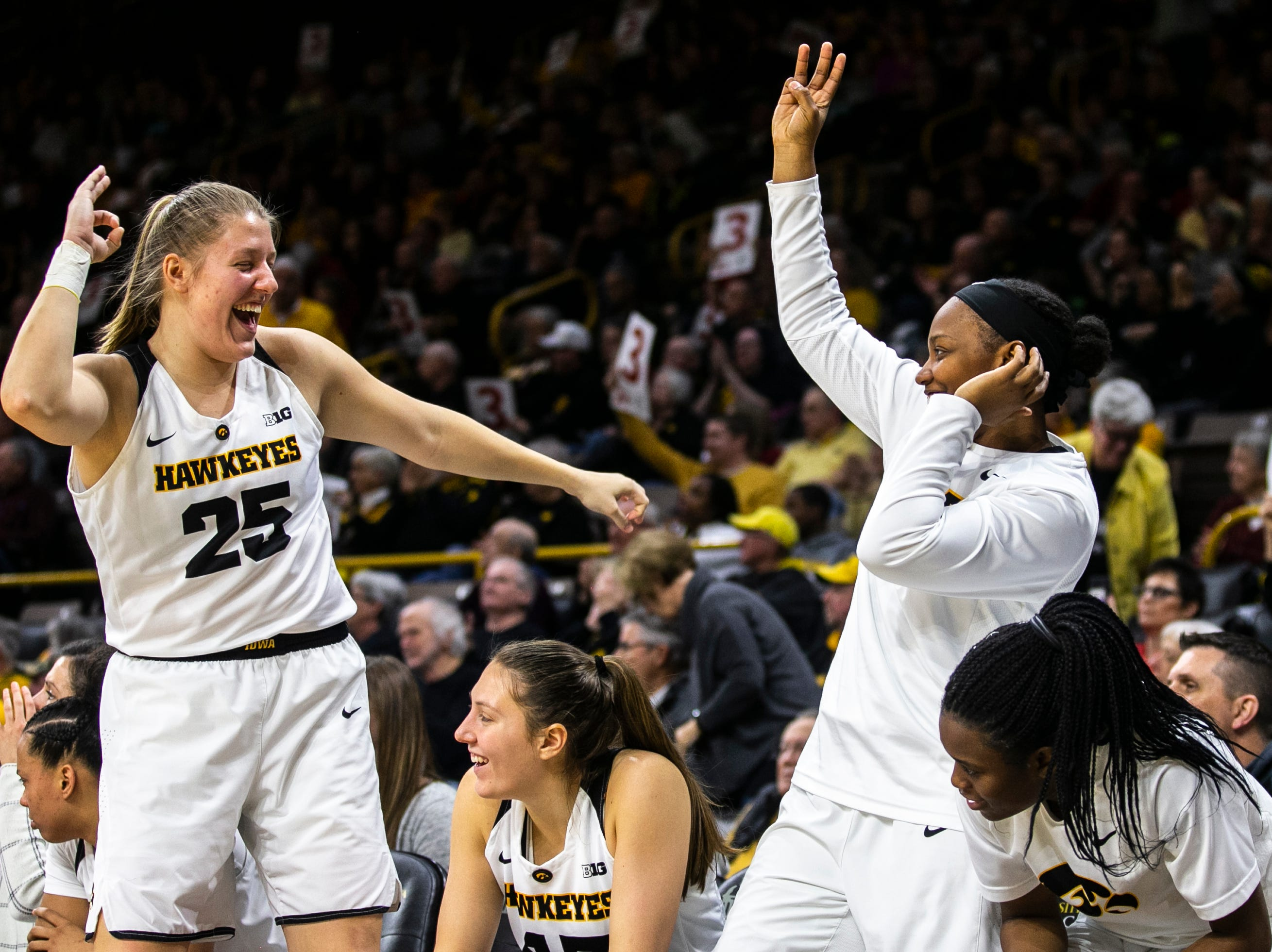 Iowa's Monika Czinano (25) celebrates on the bench with teammates during a NCAA Big Ten Conference women's basketball game on Sunday, Jan. 27, 2019, at Carver-Hawkeye Arena in Iowa City, Iowa.