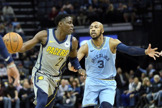 Jan 26, 2019; Memphis, TN, USA; Indiana Pacers guard Darren Collison (2) drives against Memphis Grizzlies guard Jevon Carter (3) in the first quarter at FedExForum. Mandatory Credit: Nelson Chenault-USA TODAY Sports