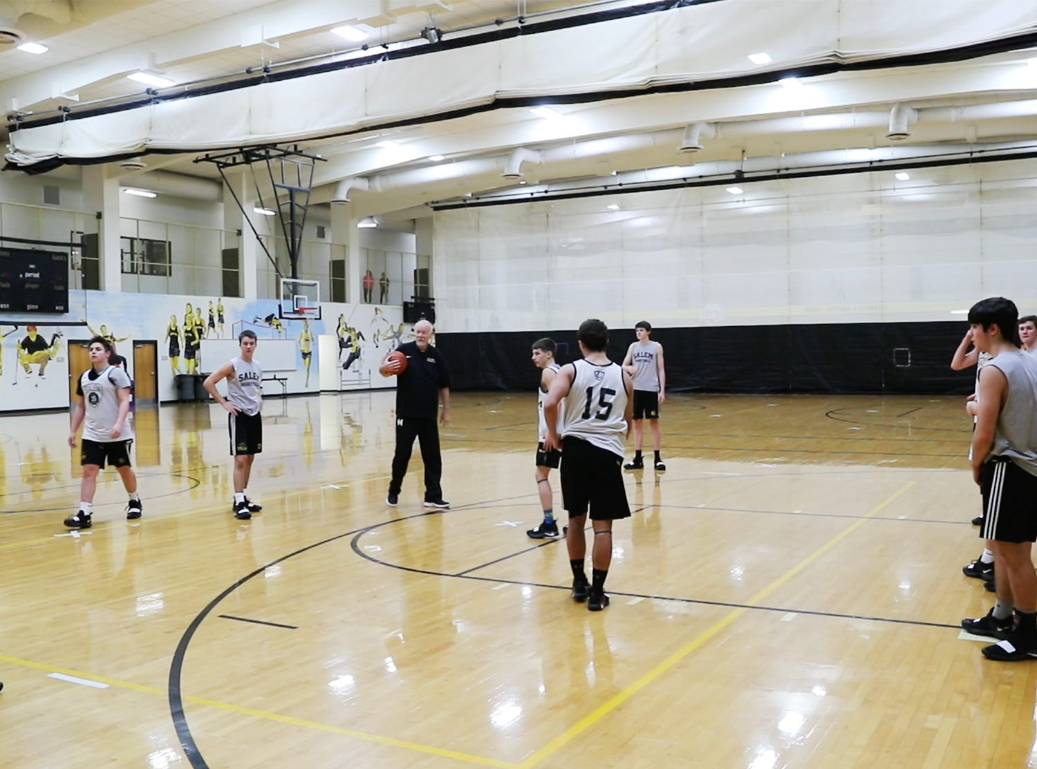 Salem High School Boys Basketball Coach Mike Brown, right, runs a team practice at Salem High School in Salem Ind. on Tuesday, Jan. 23, 2019. His step son Jalen Pigg, who has helped him with coaching for yers, was born with Down Syndrome and is now battling a form of leukemia but has a lot of support from the team.