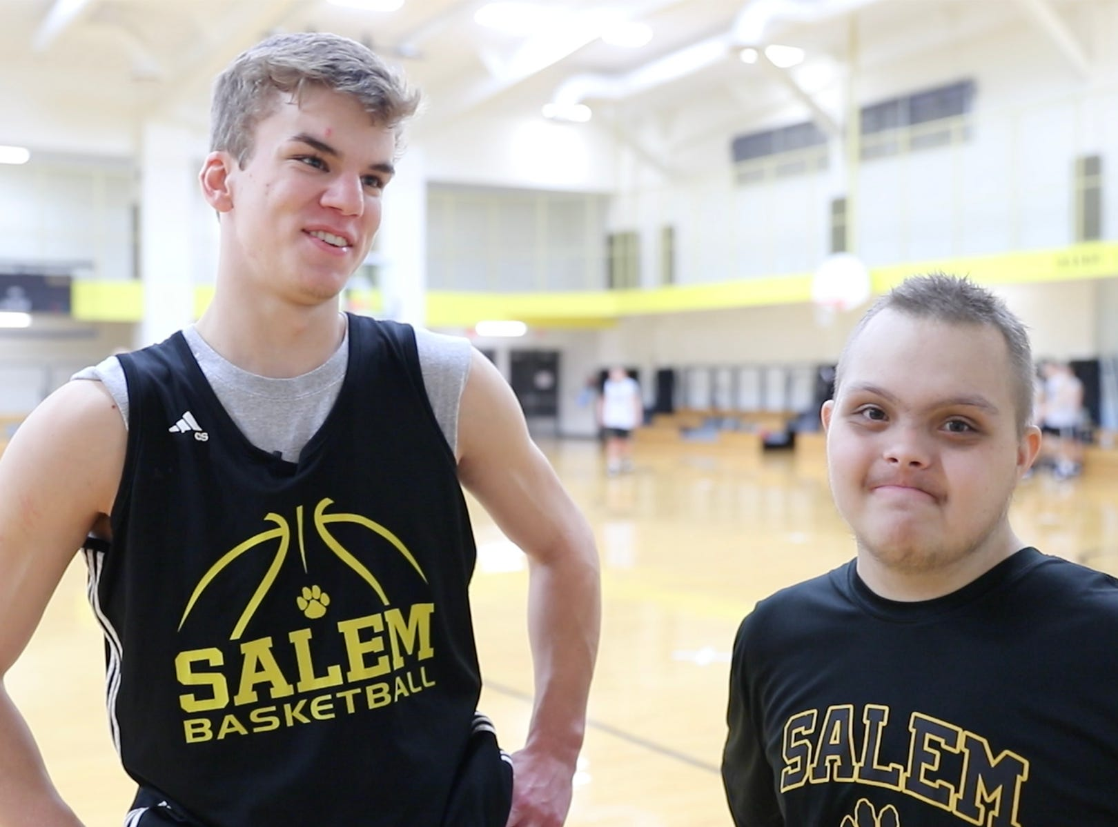 Salem High School Boys Basketball player Brandon Pepmeier, left, and Jalen Pigg, right, know each other from both thier involvement coaching and participating in the Special Olympics, but now Jalen's step dad, Mike Brown is also the Salem High School Boys Basketball Coach at Salem High School in Salem Ind. on Tuesday, Jan. 23, 2019. Jalen, who was born with Down Syndrome, is now battling a form of leukemia but has a lot of support from the team and his loving family.
