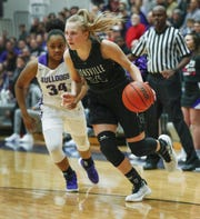Zionsville Eagles  Maddie Nolan (24) drives by Brownsburg Bulldogs Aminah Thomas (34) in the first half of their game at Brownsburg High School Friday, Jan. 25, 2019.