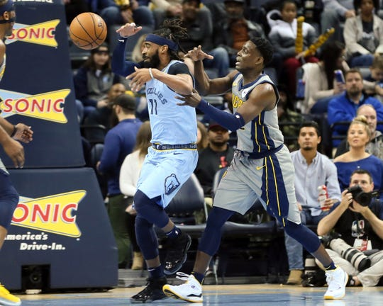 Jan 26, 2019; Memphis, TN, USA; Indiana Pacers guard Darren Collison (2) fouls Memphis Grizzlies guard Mike Conley (11) in the first quarter at FedExForum. Mandatory Credit: Nelson Chenault-USA TODAY Sports