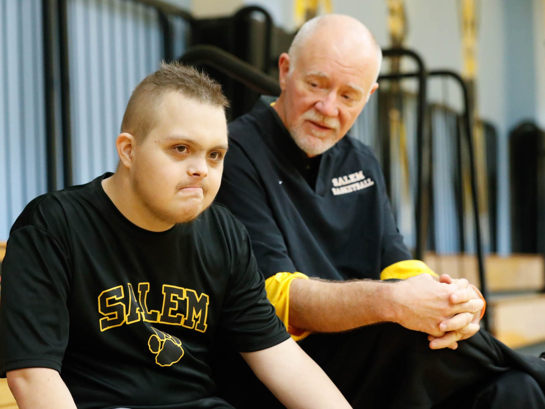 Jalen Pigg and his stepdad, Salem High School Boys Basketball Coach Mike Brown, rest for a moment on the bleachers during a team practice at Salem High School in Salem, Indiana, on  Jan. 23, 2019. Jalen, who was born with Down Syndrome, is now battling a form of leukemia.
