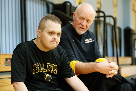 Salem High School basketball coach Mike Brown (right) said any cuts to Special Olympics would hurt some very special people.