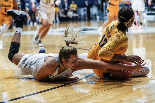 Butler Bulldogs forward Tori Schickel (34) fights to get the ball away from Marquette Golden Eagles forward Erika Davenport (12) in the second half of the game at Hinkle Fieldhouse in Indianapolis, Sunday, Jan. 27, 2019. Butler lost to Marquette, 58-87.