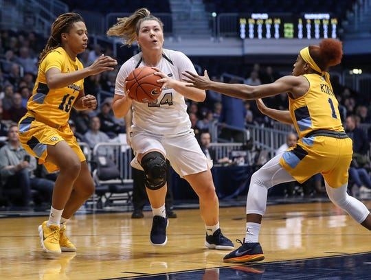 Marquette Golden Eagles guard Amani Wilborn (15) and guard Danielle King (1) surround Butler Bulldogs guard Kristen Spolyar (24) as she takes the ball to the hoop in the first half of the game at Hinkle Fieldhouse in Indianapolis, Sunday, Jan. 27, 2019. Butler lost to Marquette, 58-87.