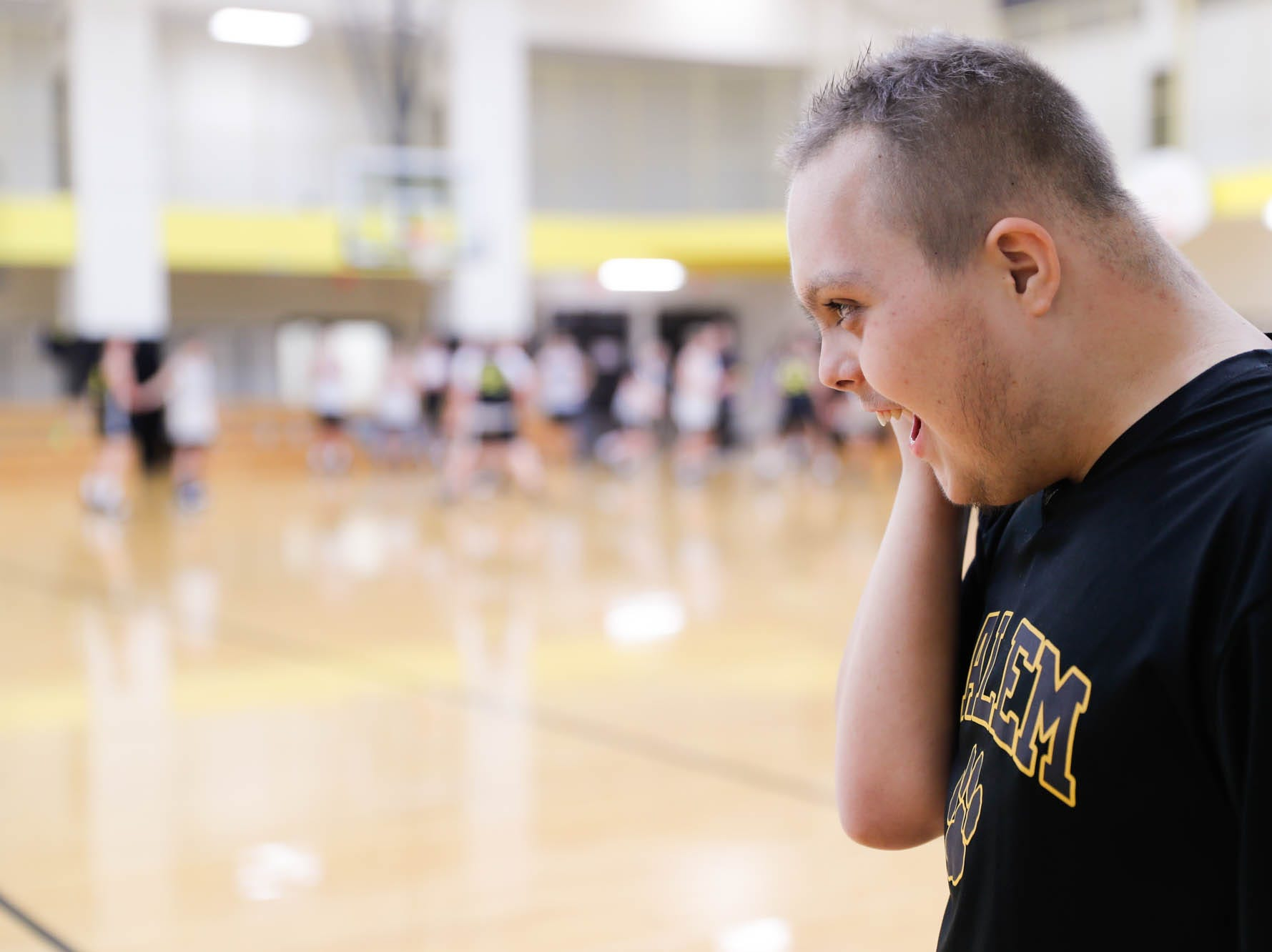 """Jalen Pigg, the step son of Salem High School Boys Basketball Coach, Mike Brown, sings the song """"Shallow"""", from the film """"A Star Is Born"""" at Salem High School in Salem Ind. on Tuesday, Jan. 23, 2019. Jalen, who was born with Down Syndrome, is now battling a form of leukemia but has a lot of support from the team."""