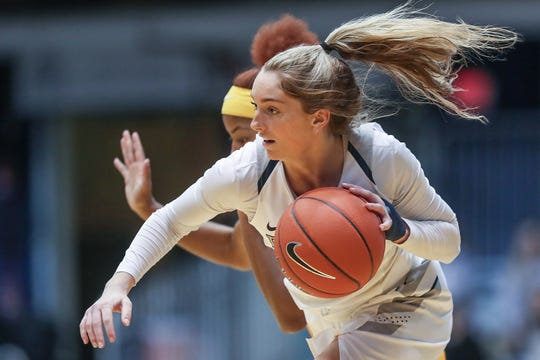 Butler Bulldogs guard Michelle Weaver (11) drives toward the hoop in the second half of the game at Hinkle Fieldhouse in Indianapolis, Sunday, Jan. 27, 2019. Butler lost to Marquette, 58-87.