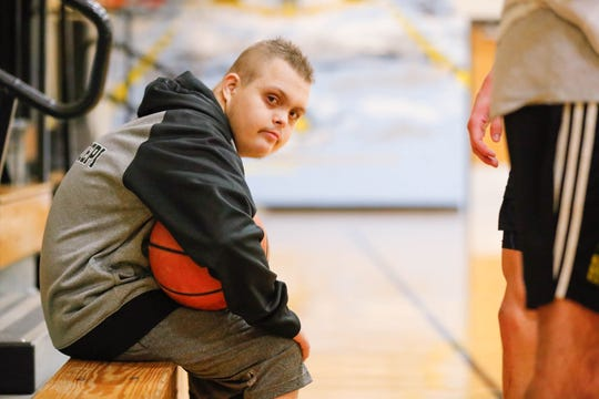 Jalen Pigg watches his stepdad's basketball practice at Salem High School Jan. 23, 2019.