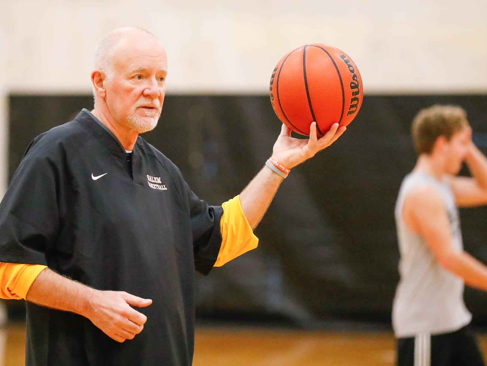 Salem High School Boys Basketball Coach, Mike Brown, runs a practice with his step son Jalen Pigg, not shown, at Salem High School in Salem Ind. on Tuesday, Jan. 23, 2019. Jalen, who was born with Down Syndrome, is now battling a form of leukemia but has lots of love and support from the team and his family.