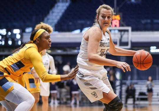 Marquette Golden Eagles forward Erika Davenport (12) guards Butler Bulldogs forward Tori Schickel (34) as she works a possession in the first half of the game at Hinkle Fieldhouse in Indianapolis, Sunday, Jan. 27, 2019. Butler lost to Marquette, 58-87.