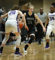 Zionsville Eagles  Maddie Nolan (24) looks to dribble around Brownsburg Bulldogs Allison Bosse (20) in the first half of their game at Brownsburg High School Friday, Jan. 25, 2019.