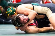 Iowa City West's Hunter Garvin, top, wrestles Cedar Falls' Jacob Penrith at 120 during the Mississippi Valley Conference wrestling super meet tournament on Saturday, Jan. 26, 2019, at West High School in Iowa City, Iowa. Garvin scored a tech. fall over Cedar Falls' Jacob Penrith.